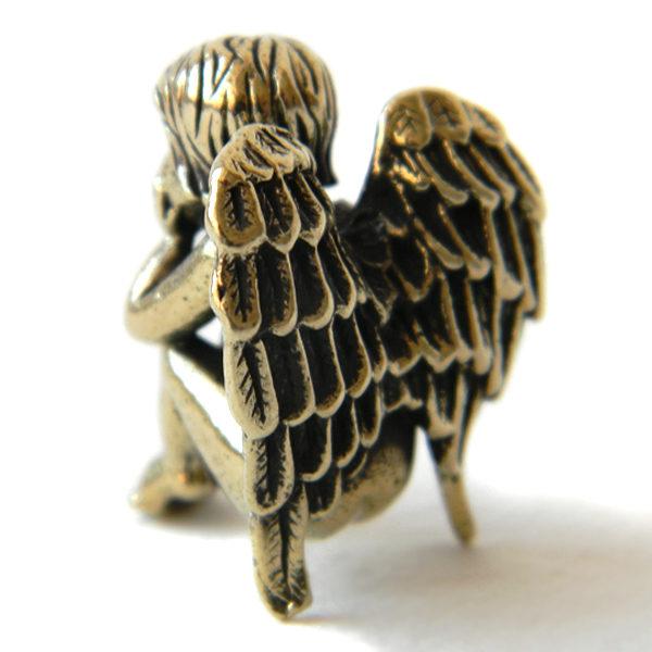 Купить металлическую фигурку обиженного ангелочка