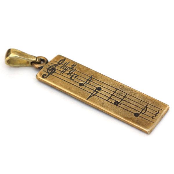 бронзовый кулон с нотами подарок музыканту купить в крыму оптом